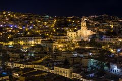 Night view of Modica and the illuminated San Giorgio cathedral. In Sicily, Italy Stock Photography