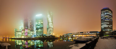 Night view of Moscow City. Night panorama of Moscow City. The tops of the skyscrapers are hidden in the cloud Royalty Free Stock Images