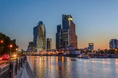 Night view of the Moscow City Tower. Night view of the tower of Moscow City and reflected illumination lights in the river Royalty Free Stock Images
