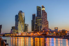 Night view of the Moscow City Tower. Night view of the tower of Moscow City and reflected illumination lights in the river Royalty Free Stock Photo