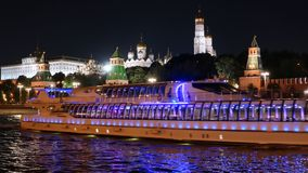 Night view of Moscow Kremlin. And Moskva river with cruise ships, Russia stock footage