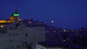 Night view on the mountain of Jerusalem. Night view with the moon on the mountain of Jerusalem and the wall and the minaret stock footage