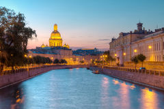 Night view on Moyka River and Saint Isaac's Cathedral Stock Images
