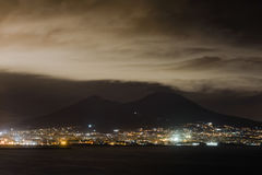 Night view of Naples with Vesuvius volcano silhouette, Campania,. Night view of the city and port of Naples with Vesuvius volcano silhouette on the background Stock Images