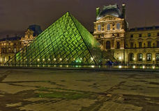 Night view on National Gallery of Louvre, Paris Stock Photos