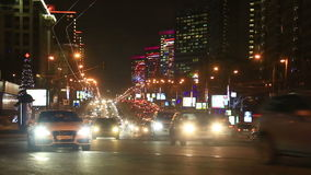 Night view of New Arbat traffic in Moscow, Russia. Heavy traffic of New Arbat avenue, former Kalininsky prospect, with illuminated buildings decorated for stock footage