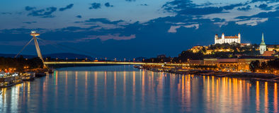 Night view on new bridge in Bratislava with castle on right side. And lights reflection on Dunaj river royalty free stock image