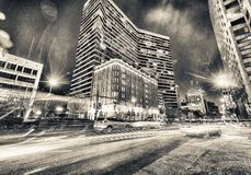 Night view of New Orleans buildings from street level.  stock photography