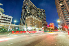 Night view of New Orleans buildings from street level Stock Photos