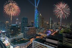 Night view 2018 new year celebration with skyscraper in business. District in Bangkok Thailand. Light show at Magnolias Ratchaprasong in Bangkok, Thailand Stock Photo
