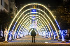 Night view of New Year or Christmas decorative arches with bright lights during winter holidays in Ivano-Frankivsk city, Ukraine. royalty free stock photo