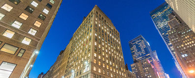 Night view of New York buildings from street level Stock Images