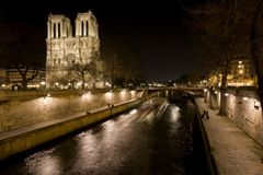 Night View of Notre Dame de Paris and Seine river Royalty Free Stock Photos