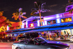 Night view at Ocean drive in South Miami. MIAMI BEACH - July 28: Night view at Ocean drive on July 28, 2013 in Miami Beach, Florida. Art Deco Night-Life in South Royalty Free Stock Images