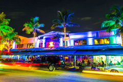 Night view at Ocean drive in South Miami. MIAMI BEACH - July 28: Night view at Ocean drive on July 28, 2013 in Miami Beach, Florida. Art Deco Night-Life in South Stock Photos