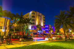 Night view at Ocean drive in South. MIAMI BEACH - July 28: Night view at Ocean drive on July 28, 2013 in Miami Beach, Florida. Art Deco Night-Life in South Beach Royalty Free Stock Photos