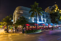 Night view at Ocean drive in South. MIAMI BEACH - July 28: Night view at Ocean drive on July 28, 2013 in Miami Beach, Florida. Art Deco Night-Life in South Beach Royalty Free Stock Photo