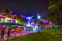 Night view at Ocean drive in South. MIAMI BEACH - July 28: Night view at Ocean drive on July 28, 2013 in Miami Beach, Florida. Art Deco Night-Life in South Beach Stock Photos