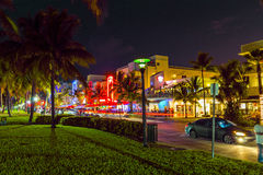 Night view at Ocean drive in South. MIAMI BEACH - July 28: Night view at Ocean drive on July 28, 2013 in Miami Beach, Florida. Art Deco Night-Life in South Beach Royalty Free Stock Image