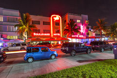 Night view at Ocean drive in South. MIAMI BEACH - July 28: Night view at Ocean drive on July 28, 2013 in Miami Beach, Florida. Art Deco Night-Life in South Beach Royalty Free Stock Photography