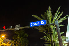 Night view at Ocean drive in South. Street sign Ocean Drive at night in South Beach, Miami with palms Royalty Free Stock Photo