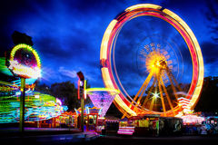 Night view at Odessa ferriswheel. Evening in Odessa city. Entertainment in park Shevchenko and its attractions Stock Image