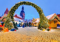 Night View Of A Beautiful Entrance To The Christmas Market In Winter Riga In Latvia Stock Photo