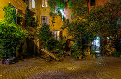 Night view of old cozy courtyard in Rome Royalty Free Stock Photography