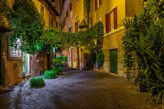 Night view of old cozy street in Trastevere in Rome stock photos