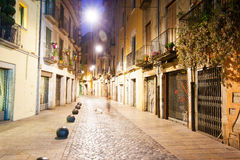 Night view of old narrow street royalty free stock photography