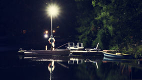 Night view of the old pier for boats on the river. Travel. Tourism. Recreation Royalty Free Stock Image