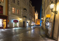 Night view of old street and Astronomical Clock Orloj in Prague Royalty Free Stock Image