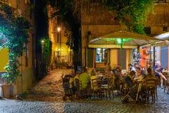 Night view of old street in Trastevere in Rome stock image