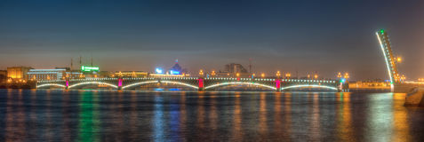 Night view of open Trinity Bridge and Neva River. Night panoramic view of illumunated open Trinity Bridge and Neva River, St. Petersburg, Russia royalty free stock photo
