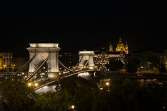 Night view over Chain Bridge St Stephen's Basilica Budapest royalty free stock photos
