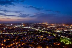 Night view over Osh, Kyrgyzstan. Night view over illuminated Osh town, Kyrgyzstan royalty free stock image