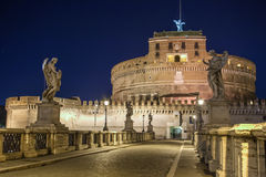 Night view over Ponte Sant Angelo leading to castel Sant Angelo at night. Rome, Italy Royalty Free Stock Photos