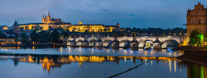 Night view over river Vltava to Charles bridge and Prague castle Royalty Free Stock Photo