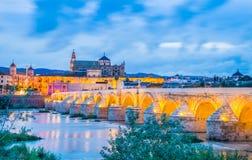 Night view over the roman bridge in Cordoba, Spain Royalty Free Stock Photos