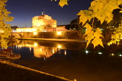 Night view over the Tevere river and the Sant'Angelo castle and bridge Royalty Free Stock Image