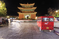 Night view of the Pagoda in the city center of Heqing in Yunnan. This pagoda is the landmark if the city. Tourists and cars passin Stock Photography