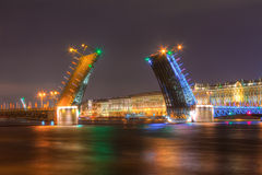 Night view of Palace Bridge and Palace Embankment. Night view of illuminated Neva River, open Palace Bridge and Palace Embankment, Saint Petersburg, Russia Royalty Free Stock Images