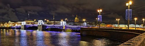 Night view of Palace bridge in St. Petersburg. Wide angle night view of Palace bridge is decorated with festive illuminations in St. Petersburg Stock Photo