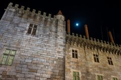 Night view of Palace of the Duques of Braganca. GUIMARAES, PORTUGAL - CIRCA APRIL 2018: Night view of Palace of the Duques of Braganca, Guimaraes, Portugal royalty free stock photos