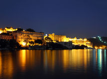 Night view on palace and lake in Udaipur Stock Photo
