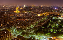 Night view of Paris with Church at the Invalides. Night skyline of Paris with brightly lit dome of the Church at the Invalides, and Pantheon visible in the Stock Image