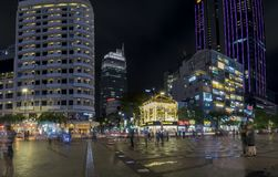 Night view on pedestrian street with wide path along the skyscrapers many lights. Ho Chi Minh City, Vietnam - December 21st, 2017: Night view on pedestrian Stock Photo
