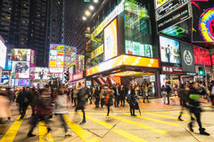 Night view of people walking at crowded city. Hong Kong Stock Images