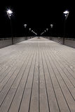 Night view of a pier and lamp posts Royalty Free Stock Image