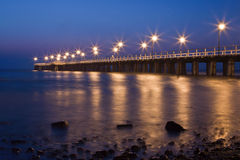 Night view of the pier at the seaside. Night by the sea royalty free stock images